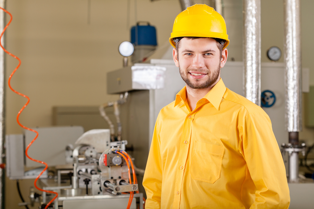 Young engineer during working in factory, horizontal